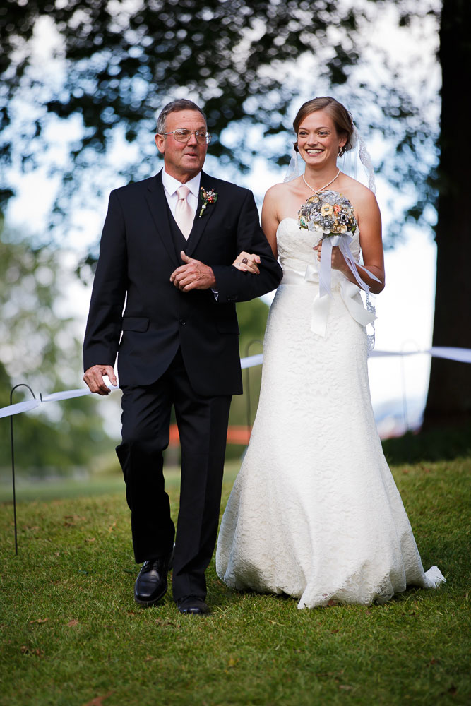 bride and father walk aisle maryland wedding photographer