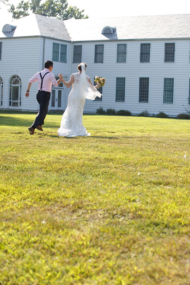 bride and groom exit annapolis wedding photographer