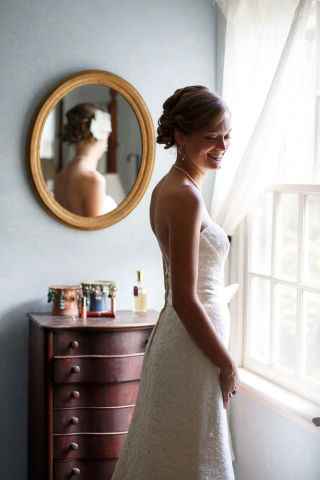 bride by window annapolis wedding photogher